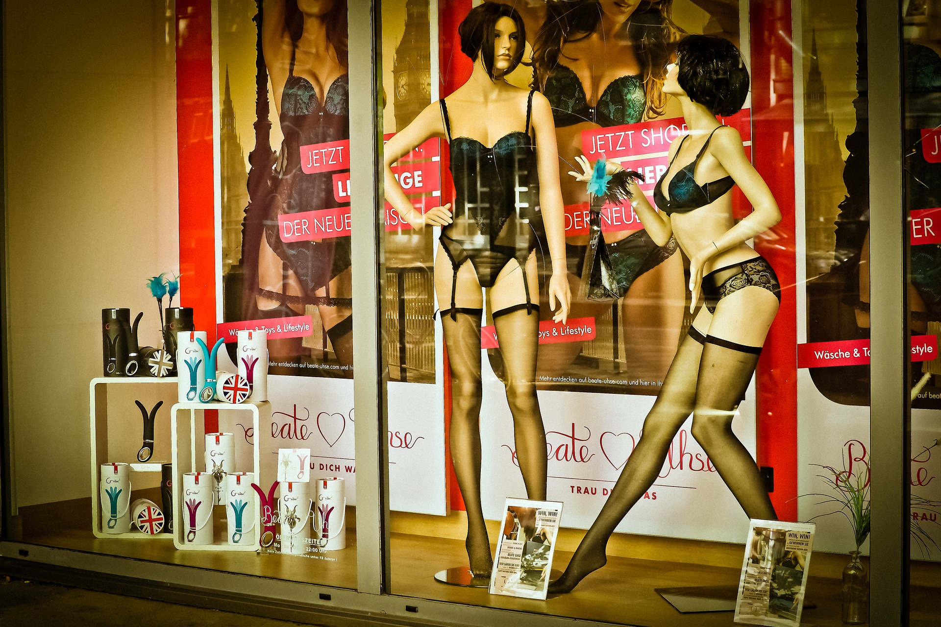 front window of a sx toy store with mannequins in sexy lingerie
