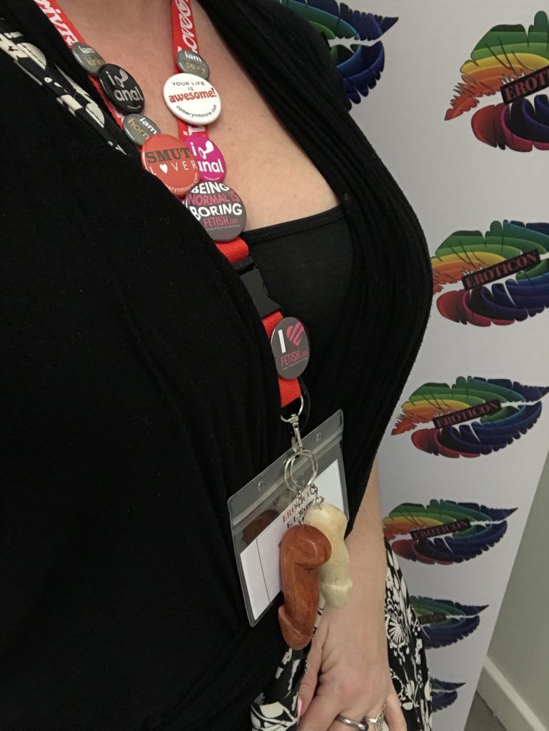 me wearing my Eroticon name badge with just the badge and my cleavage showing