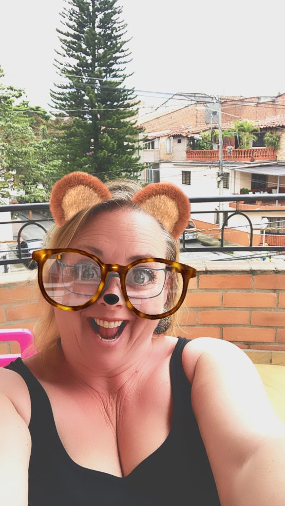using a iler with bear ears and glasses on the patio