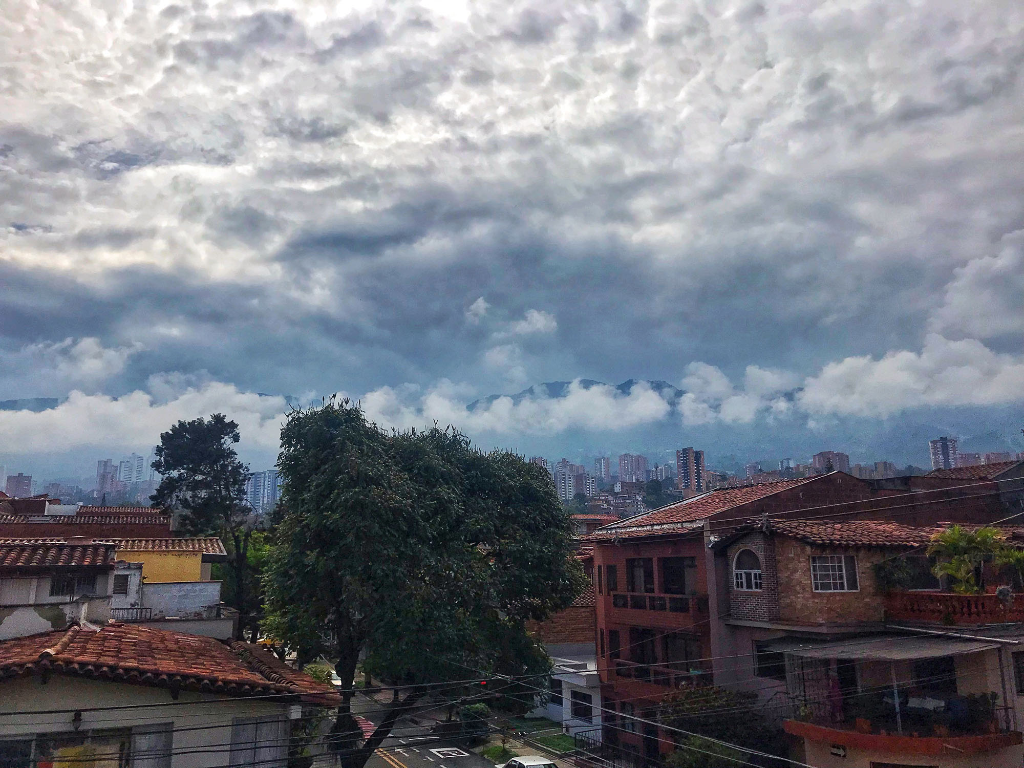 Beautiful clouds over rooftops in Medellin