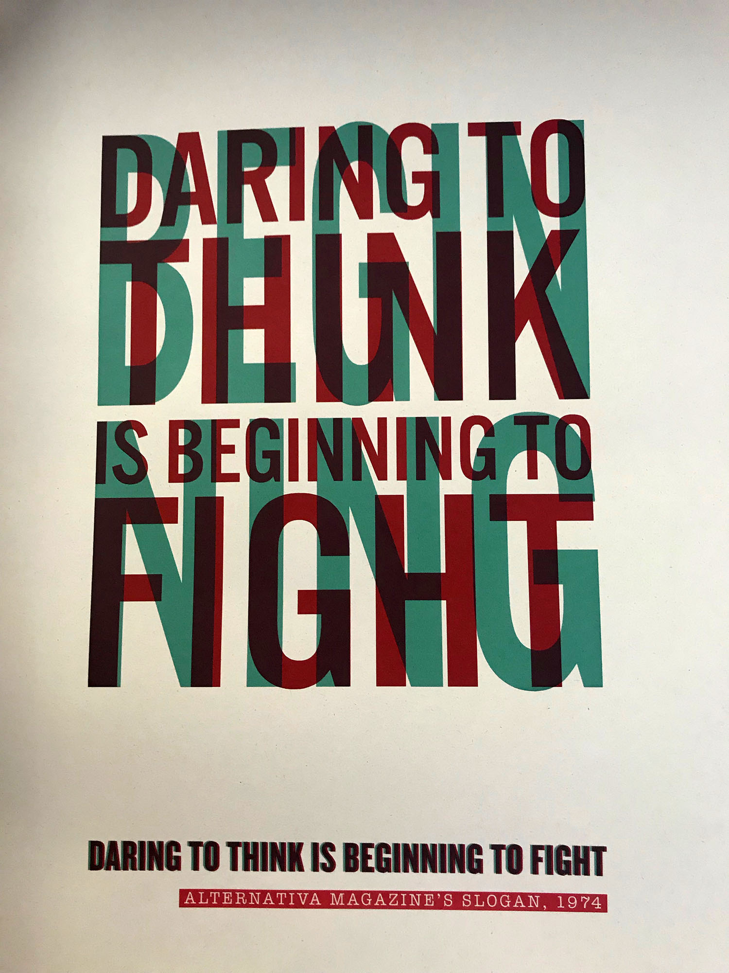 Sign that says- daring to think is beginning to fight