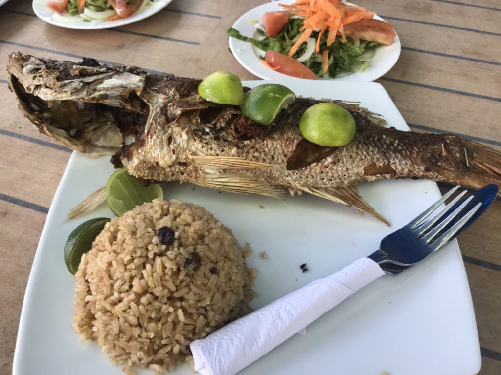 Whole fried fish with limes and rice