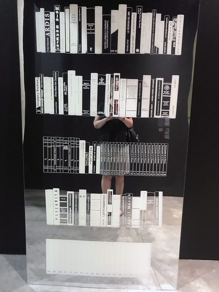 Mirror with books etched on it and I am in the background