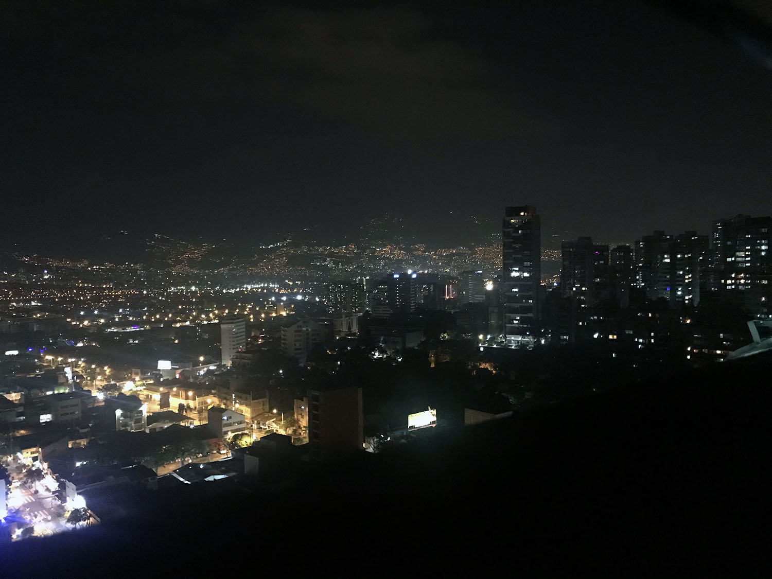 View of the city at night from rooftop bar