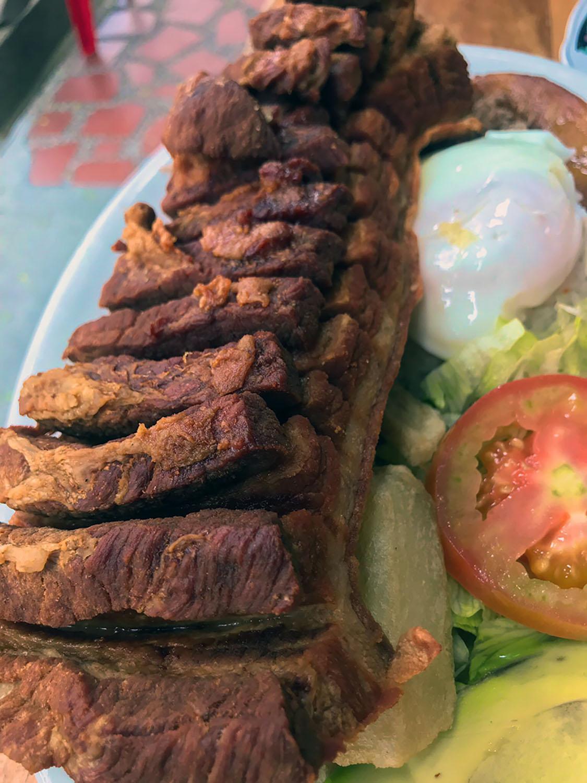 A giant chicharron on a plate!