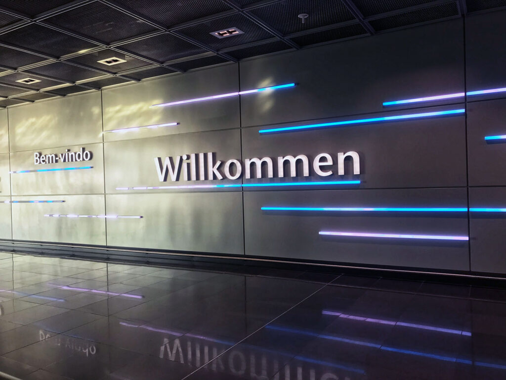 Airport sign Wilkommen